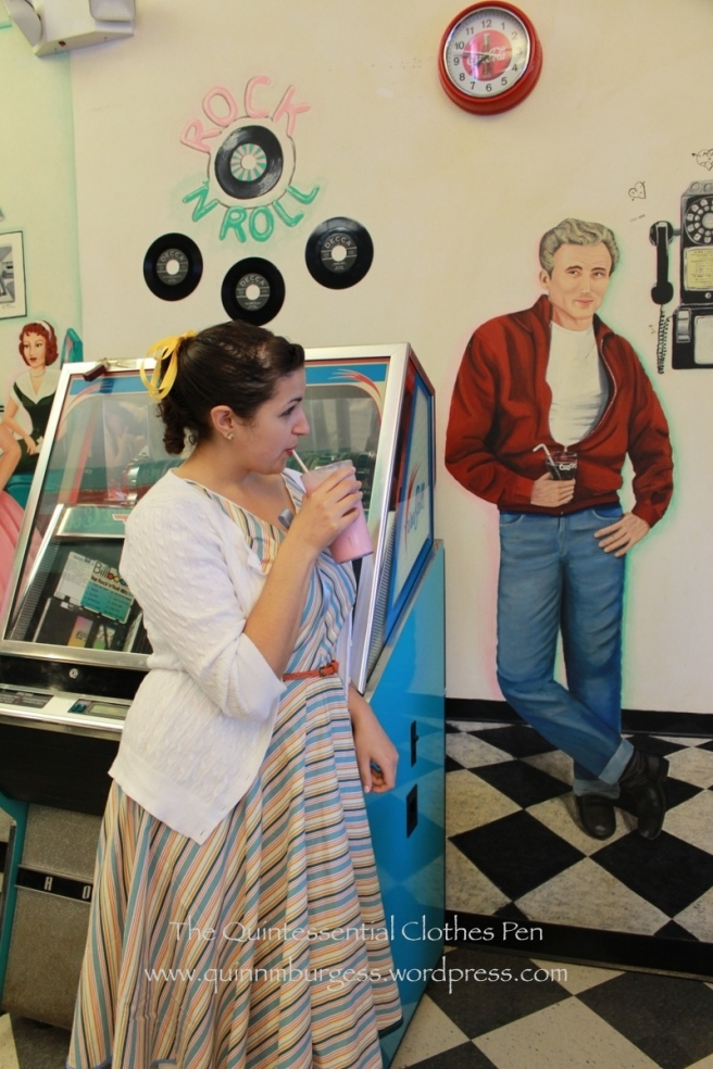 The actual owner of the pink shake also posed by the juke box. That guy on the wall is pretty funny.
